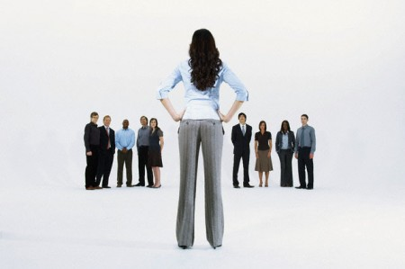 Businesswoman deciding between two groups of people