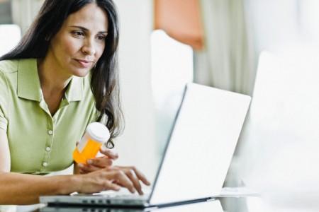 Woman Refilling Prescription Online --- Image by © Tim Pannell/Corbis