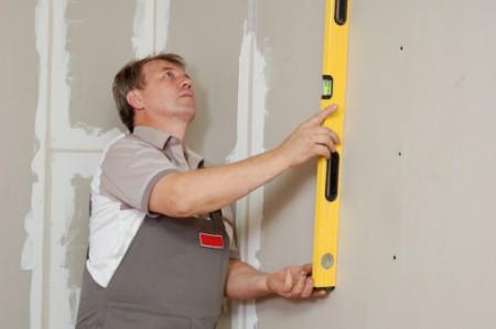 man with level make renovation