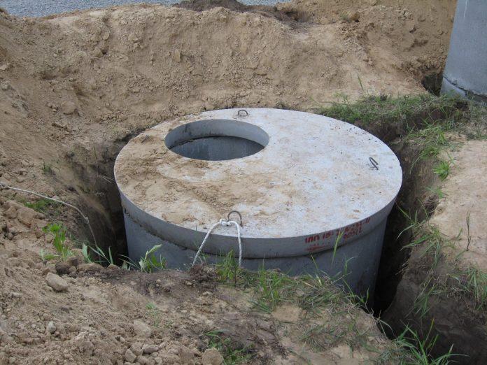выгребную яму