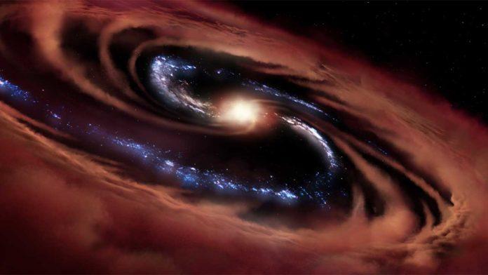 Найдена необычная галактика, рождающая звезды, несмотря на массивную черную дыру